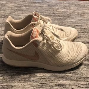 White and rose gold Nike's